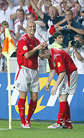 England v Croatia - Estadio de Luz, Lisbon - 21st June 2004<br />England's captain David Beckham congratulates goalscorer Wayne Rooney during his ritual pulling up of his socks after scoring a goal<br />Photo: Jed Leicester/Sporting Pictures<br />© Sporting Pictures (UK) Ltd<br />www.sportingpictures.com<br />Tel: +44 (0)20 7405 4500<br />Fax: +44 (0)20 7831 7991