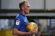 AFC Wimbledon midfielder Mitchell (Mitch) Pinnock (11) holding ball during the EFL Sky Bet League 1 match between AFC Wimbledon and Southend United at the Cherry Red Records Stadium, Kingston, England on 24 November 2018.
