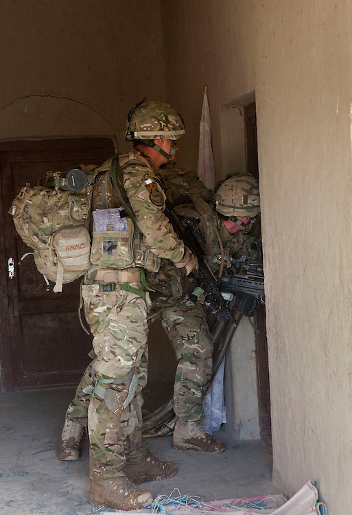 Soldiers from B Coy 3 Scots search a compound during Operations Tora Pishaw aimed at disrupting insurgent activity in their AO (Area of Operations.  Minutes later as they entered an ajoining compound an IED exploded severely wounding Pte Stephen Bainbridge who lost both legs as a result of the blast. Loya Manda, Nad e Ali North, Helmand Province, Afghanistan on the 11th of November 2011.