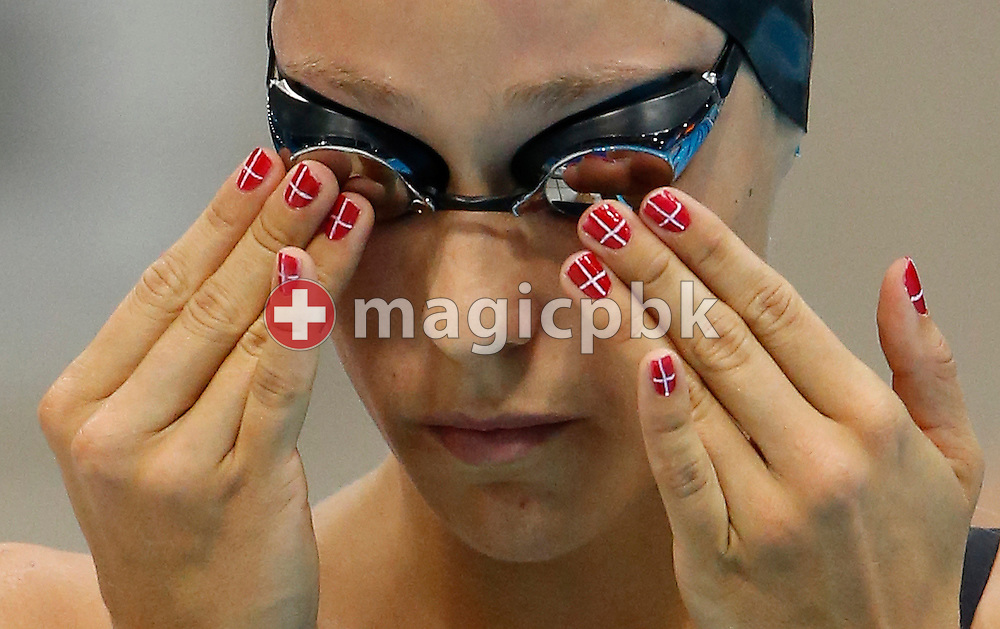 Rikke Moeller Pedersen of Denmark adjusts her goggles before competing in the women's 200m Breaststroke Semifinal during the Swimming competition held at the Aquatics Center during the London 2012 Olympic Games in London, Great Britain, Wednesday, August 1, 2012. (Photo by Patrick B. Kraemer / MAGICPBK)