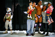 Lucha Libre AAA wrestlers Mascarita Sagrada, left, and El Mesias pose with fans in Sacramento, CA March 28, 2009.