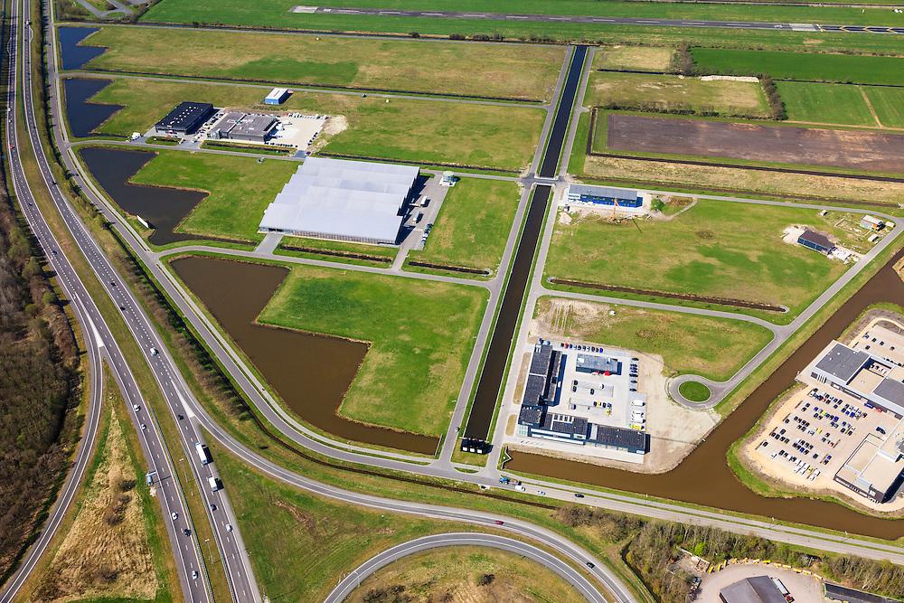 Nederland, Friesland, Gemeente Smallingerland, 01-05-2013; Bedrijvenpark Drachten Azeven, gelegen in de oksel van knooppunt Drachten (A7/N31). De structuur van de polders van Drachtstercompagnie (Fries: Drachtster Kompenije) wordt aangetast.<br /> The structure of the polders is affected by the development of  business park Drachten Azeven. Motorway seperates the polder from the city.<br /> luchtfoto (toeslag op standard tarieven)<br /> aerial photo (additional fee required)<br /> copyright foto/photo Siebe Swart