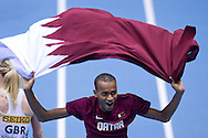 Mutaz Essa Barshim of Qatar celebrates his gold medal and World Champion title after men's high jump final during the IAAF Athletics World Indoor Championships 2014 at Ergo Arena Hall in Sopot, Poland.<br /> <br /> Poland, Sopot, March 9, 2014.<br /> <br /> Picture also available in RAW (NEF) or TIFF format on special request.<br /> <br /> For editorial use only. Any commercial or promotional use requires permission.<br /> <br /> Mandatory credit:<br /> Photo by © Adam Nurkiewicz / Mediasport
