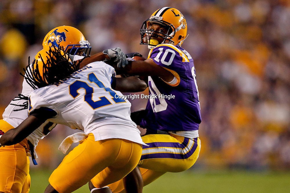 October 16, 2010; Baton Rouge, LA, USA; LSU Tigerswide receiver Russell Shepard (10) is tackled by McNeese State Cowboys cornerback Seth Thomas (8) and cornerback Jarron Jackson (21) during the first half at Tiger Stadium.  Mandatory Credit: Derick E. Hingle
