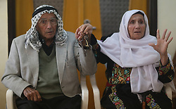 59645961  .Abu Hafez and his wife show the keys of their former house they displaced since 1948, in Al-Jalazoun Refugee camp near Ramallah in the West Bank on May 14, 2013. Palestinians are preparing for Nakba Day on May 15, marking thousands of Palestinians that were forced to leave their homes during the Arab-Israeli war in 1948, May 14, 2013. Photo by: imago / i-Images. UK ONLY