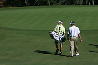 Pro Caddie, Ted Scott and PGA rookie, Bubba Watson walks down the fairway on the 12th hole during the first day of the Pro Am that was held at Forest Oaks golf club in Greensboro, NC Monday October 2, 2006&amp;#xD;Photo by David Duncan&amp;#xD;<br />