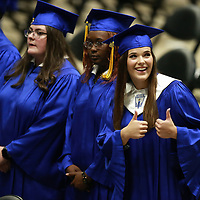 """Camryn Cox gives her family the """"thumbs up"""" as she takes her seat Friday night for her graduation."""