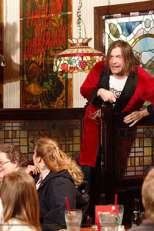 """Jerry Francis as Parker Bradley during Mayhem & Mystery's production of """"Game Night Grudge"""" at the Spaghetti Warehouse in downtown Dayton, Monday, March 4, 2013."""