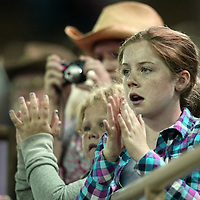 Fans react to the action during the 129th performance of the PRCA Silver Spurs Rodeo at the Silver Spurs Arena   on Friday, June 1, 2012 in Kissimmee, Florida. (AP Photo/Alex Menendez) Silver Spurs rodeo action in Kissimee, Florida. PRCA rodeo event in Florida. The 129th annual running of the cowboy event.