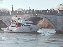 """© Licensed to London News Pictures. 16/03/2014. Richmond, UK. The boat successfully makes it through. The pleasure cruiser """"The Victoria"""" crashes into Richmond Bridge in surrey today 16th March. There was considerable damage to the vessel. The boat eventually made it through the bridge to cheers from crowds who were enjoying the sunny weather along the River Thames. . Photo credit : Michael Traboulsi/LNP"""