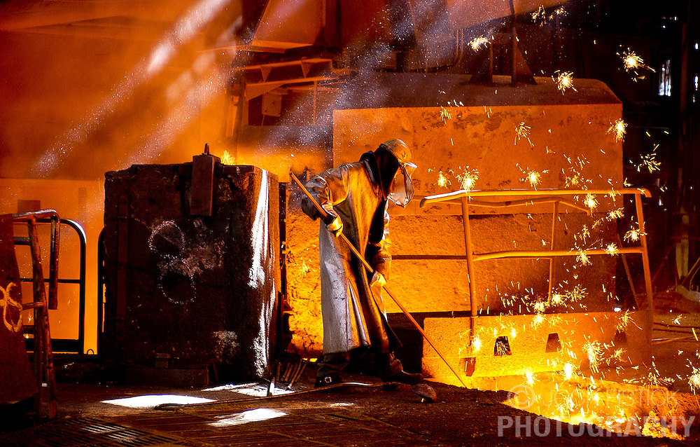 An Arcelor employee uses a probe to monitor the temperature of a blast furnace at the Seraing facility near Liege, Belgium. (Photo © Jock Fistick)