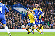 Scunthorpe's JamieNess is hassled by Chelsea's Diego Costa during the The FA Cup third round match between Chelsea and Scunthorpe United at Stamford Bridge, London, England on 10 January 2016. Photo by Shane Healey.