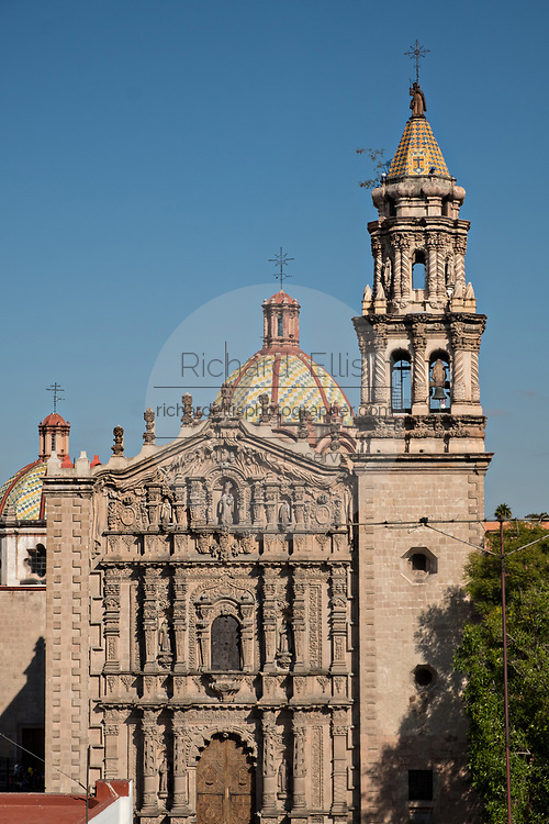The Baroque Churrigueresque style Iglesia del Carmen church and convent in the historic center on the Plaza del Carmen in the state capital of San Luis Potosi, Mexico.