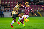 Ryotaro Meshino (#77) of Heart of Midlothian FC tackles Greg Leigh (#3) of Aberdeen FC during the Betfred Scottish Football League Cup quarter final match between Heart of Midlothian FC and Aberdeen FC at Tynecastle Stadium, Edinburgh, Scotland on 25 September 2019.