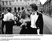 David Faber ( in a Bullingdon tailcoat ) & Sally Gilbert at the Worcester May Ball. Oxford. 27 June 1984. Film 84561f2<br />