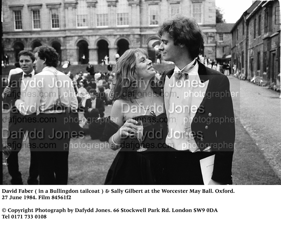David Faber ( in a Bullingdon tailcoat ) & Sally Gilbert at the Worcester May Ball. Oxford. 27 June 1984. Film 84561f2<br />© Copyright Photograph by Dafydd Jones<br />66 Stockwell Park Rd. London SW9 0DA<br />Tel 0171 733 0108