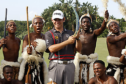 DURBAN - 12 January 2014 - South African golfer Louis Oosthuizen poses with traditional Zulu dancers and his traophy after winning the Volvo Golf Champions that was held at the Durban Country Club. Picture: Allied Picture Press/APP