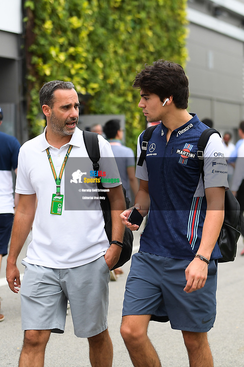 SINGAPORE - SEPTEMBER 16: Lance Stroll (18) of Williams Martini Racing arriving at the paddock for his F1 Singapore Grand Prix 2018, Marina Bay Street Circuit, Singapore on September 16, 2018. <br /> .<br /> .<br /> .<br /> (Photo by: Naratip Golf Srisupab/SEALs Sports Images)<br /> .<br /> Any image use must include a mandatory credit line adjacent to the content which should read: Naratip Golf Srisupab/SEALs Sports Images