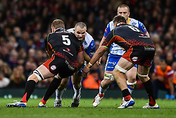 27th April 2019 , Principality Stadium , Cardiff, Wales ; Guinness pro 14's, Round 21, Dragons vs Scarlets ; Ken Owens of Scarlets is tackled by Matthew Screech of Dragons<br /> <br /> Credit :  Craig Thomas/Replay Images