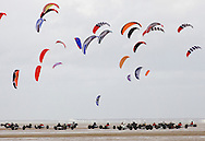 Competitors taking part in one of the races at the European Kite Buggy Championships at Hoylake, Wirral, north west England. Around 75 buggies, with both male and female pilots, from 10 countries took part in the annual event which lasted from 5-9 September 2011. The three-wheeled, single-seated, steel frame buggy was powered  by a traction, or power kite and could achieve speeds of up to 70mph/110km/h.