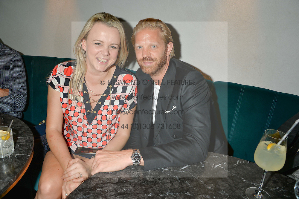SOPHIE MICHELL and ALISTAIR GUY at a party to celebrate the launch of Sackville's Bar & Grill, 8a Sackville Street, London on 15th July 2015.