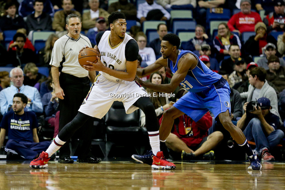 Jan 6, 2016; New Orleans, LA, USA; New Orleans Pelicans forward Anthony Davis (23) is defended by Dallas Mavericks forward Jeremy Evans (21) during the first quarter of a game at the Smoothie King Center. Mandatory Credit: Derick E. Hingle-USA TODAY Sports