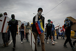 A group of opposition supporters arrive at the Francisco Fajardo expressway with shields and their faces covered in a demonstration against President Nicolas Maduro in Caracas, Venezuela on May 3, 2017.