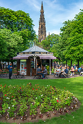 Princes Street Gardens in Edinburgh with cafe and Scott Monument to rear, Scotland, UK