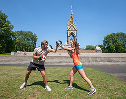 © Licensed to London News Pictures. 24/06/2020. London, UK. As Boris Johnson relaxes rules on outside gyms, Ellie Mackay 33 works out in the heat with her Personal Trainer Jorden Haynes in Kensington Gardens as forecasters predict a hot few days ahead with temperatures expected to reach over 30c. Prime Minister, Boris Johnson has announces that tourism and hospitality including pubs, restaurants and campsites and outside gyms can now reopen from the July. Photo credit: Alex Lentati/LNP