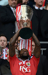 Bristol City's Jay Emmanuel-Thomas lifts the JPT Trophy  - Photo mandatory by-line: Joe Meredith/JMP - Mobile: 07966 386802 - 22/03/2015 - SPORT - Football - London - Wembley Stadium - Bristol City v Walsall - Johnstone Paint Trophy Final