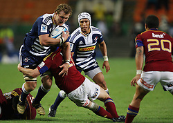 Nick Koster is tackled by Tony Brown with Gio Aplon and Aaron Smith in support during the Super Rugby (Super 15) fixture between the DHL Stormers and the Highlanders held at DHL Newlands Stadium in Cape Town, South Africa on 11 March 2011. Photo by Jacques Rossouw/SPORTZPICS