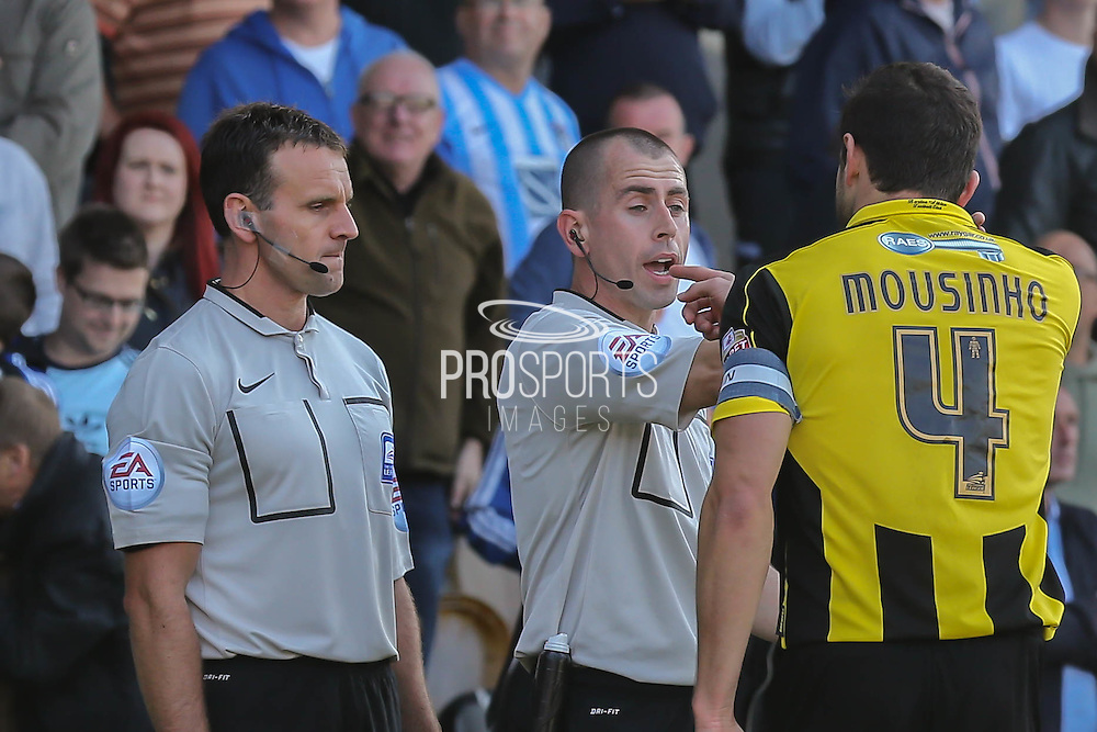Burton Albion midfielder John Mousinho skipper argues with referee and his assistant about Coventrys second goal during the Sky Bet League 1 match between Burton Albion and Coventry City at the Pirelli Stadium, Burton upon Trent, England on 6 September 2015. Photo by Simon Davies.