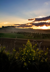 Sunset over Tuscan farmland in autumn.