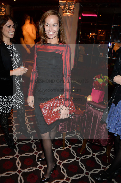 TARA PALMER-TOMKINSON at a party to celebrate the publication of 'Passion for Life' by Joan Collins held at No41 The Westbury Hotel, Mayfair, London on21st October 2013.