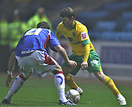 Carlisle - Saturday November 28th, 2009: Richard Keogh of Carlisle United and Wesley Houlahan of Norwich City during the FA Cup second round match at Brunton Park, Carlisle. (Pic by Andrew Stunell/Focus Images)..