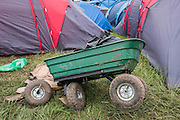 One of the many trolleys that were not up to teh mud on day one - The 2016 Glastonbury Festival, Worthy Farm, Glastonbury.
