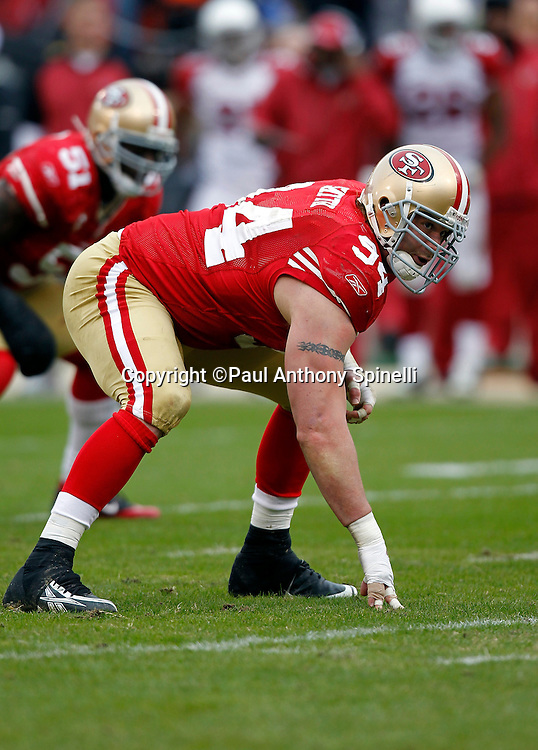 San Francisco 49ers defensive tackle Justin Smith (94) gets set in a three point stance during the NFL week 17 football game against the Arizona Cardinals on Sunday, January 2, 2011 in San Francisco, California. The 49ers won the game 38-7. (©Paul Anthony Spinelli)
