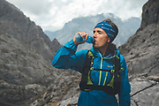 Portrait of a trail runner drinking water on a rainy day close to Collado Jermoso, Leon, Spain Trail runner running uphill in Collado Jermoso, Picos de Europa National Park, Spain
