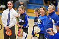 Kylie Parker stands alongside her family as she is honored during senior's night Friday, Feb. 3, 2012 at Coeur d'Alene High School in Coeur d'Alene, Idaho.