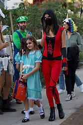 Alessandra Ambrosio dressed up as red ninja meeting her ex for trick or treat with their kids. Pierce Brosnan trick or treating. 31 Oct 2018 Pictured: Alessandra Ambrosio dressed up as red ninja meeting her ex for trick or treat with their kids. Photo credit: Dan/MEGA TheMegaAgency.com +1 888 505 6342