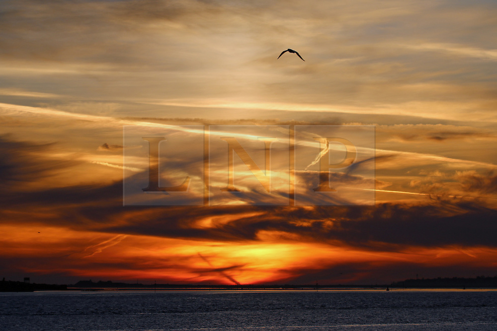 © Licensed to London News Pictures. 14/04/2015.  Tuesday 14th April got started with a deep Turneresque sky over the Thames estuary. Several days of good weather are predicted and Gravesend is often the location where the highest temperatures are recorded. Credit : Rob Powell/LNP
