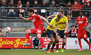 Leyton Orient striker John Marquis gets the better of Oxford midfielder Liam Sercombe during the Sky Bet League 2 match between Leyton Orient and Oxford United at the Matchroom Stadium, London, England on 17 October 2015. Photo by Bennett Dean.