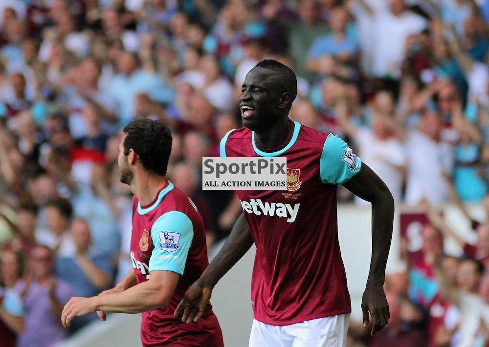 Cheikhou Kouyate winks at a team mate in celebration During West Ham United vs Bournemouth FC on Saturday the 22nd August 2015