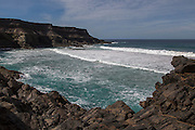 Waves breaking in a small bay near Los Molinos, west coast of Fuerteventura, Canary Islands, Spain