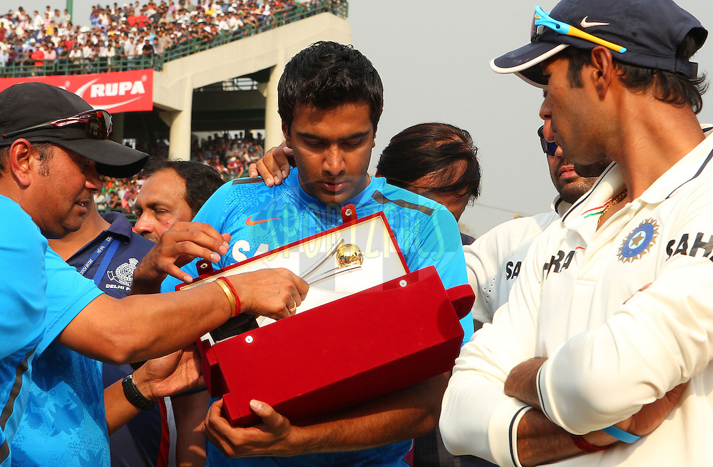 Ravichandran Ashwin of India with his man of the series trophy during day 3 of the 4th Test Match between India and Australia held at the Feroz Shah Kotla stadium in Delhi on the 24th March 2013..Photo by Ron Gaunt/BCCI/SPORTZPICS ..Use of this image is subject to the terms and conditions as outlined by the BCCI. These terms can be found by following this link:..http://www.sportzpics.co.za/image/I0000SoRagM2cIEc