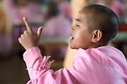 Young Nun studies out loud at Padonmar Sari Nunnery, Taunggyi, Myanmar