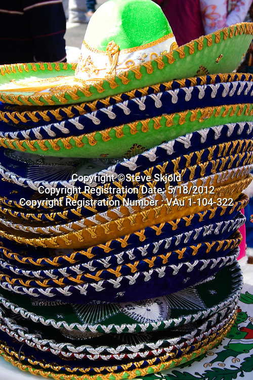 Stack of colorful Mexican sombreros for sale at sidewalk shop. Mexican Independence Day Minneapolis Minnesota MN USA