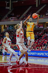 NORMAL, IL - February 05: Daniel Sackey looses control of the ball on his approach while defended by Matt Chastain and Zach Copeland during a college basketball game between the ISU Redbirds and the Valparaiso Crusaders on February 05 2019 at Redbird Arena in Normal, IL. (Photo by Alan Look)
