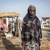 Iahawa 45 years.<br /> 11 children, only 4 are in the DPI camp the other are looking for a job in Fotokol<br /> She's from Abary, a village at 5 km from the camp<br /> 9 monthsago, Boko Haram attacked her village, they killed her husband.<br /> &quot;My husband was a fisherman, to survive here I sell some firewood&quot;