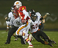 Marion's Quinn Cannoy (11) tries to get around Solon's Jonah Kuntz (53) after intercepting a pass during the first half of the game between the Solon Spartans and the Marion Indians at Thomas Park Field in Marion on Friday evening, October 5, 2012.